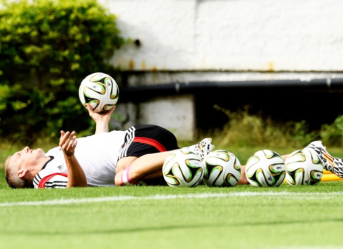 Bastian Schweinsteiger of Germany warms up during the Germany training session