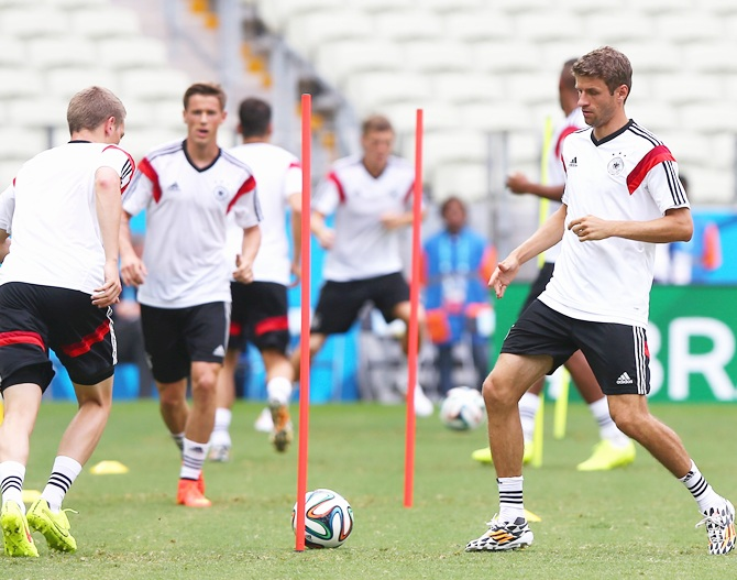 Thomas Mueller of Germany runs with the ball during the Germany training session