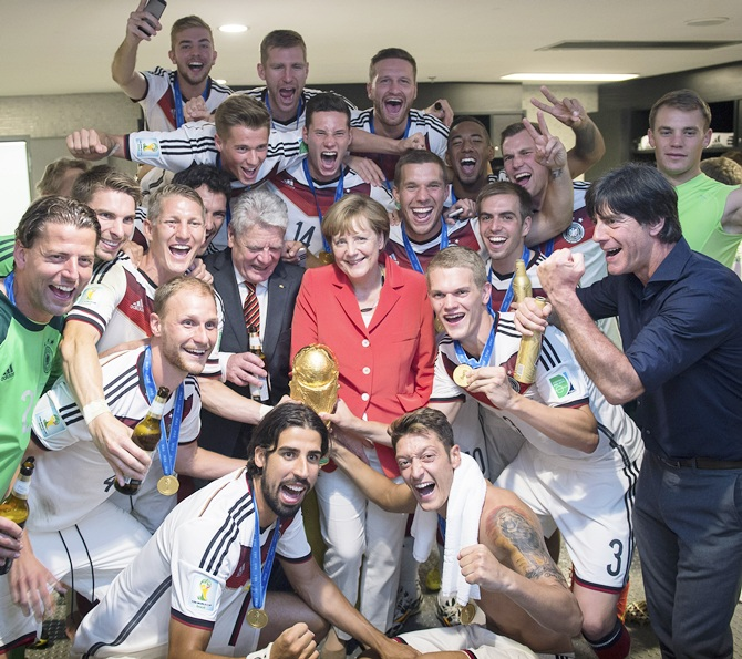 In this handout photo provided by the German Government Press Office (BPA), German   Chancellor Angela Merkel and German President Joachim Gauck celebrate with the German   national team after it's 1-0 victory in the 2014 FIFA World Cup in Brazil