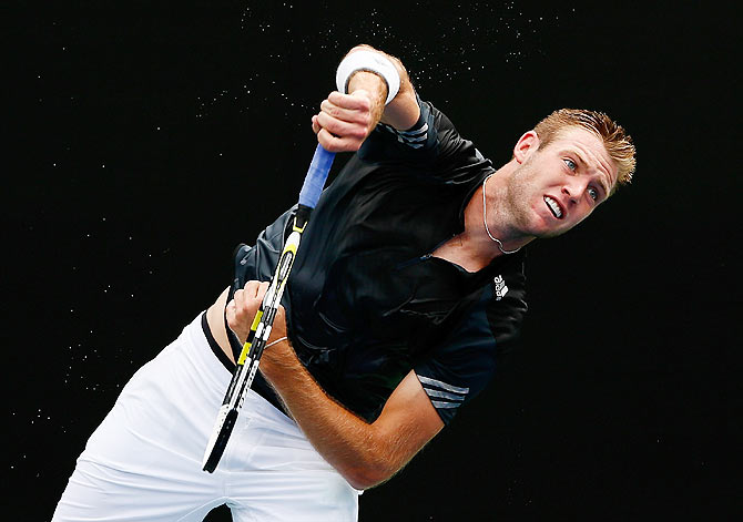 Jack Sock of the US serves