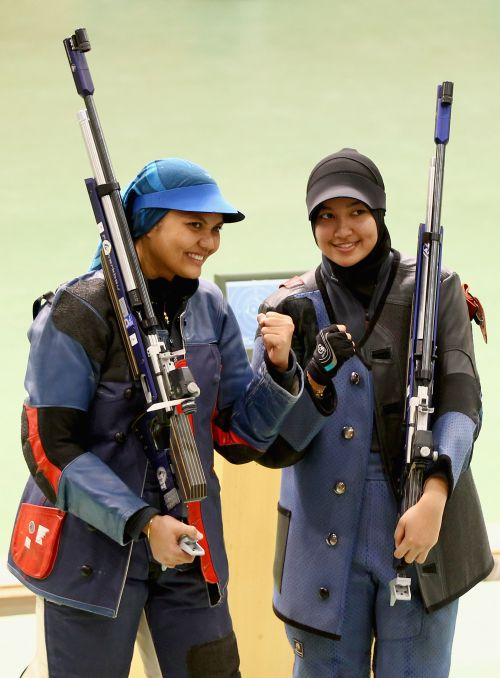 Bronze medalist Nur Suryani Mohamed Taibi (L) and Silver medalist Nur Ayuni Halim (R)   pose after the Womens 10m air rifle singles event at the Dr Karni Singh Shooting Range