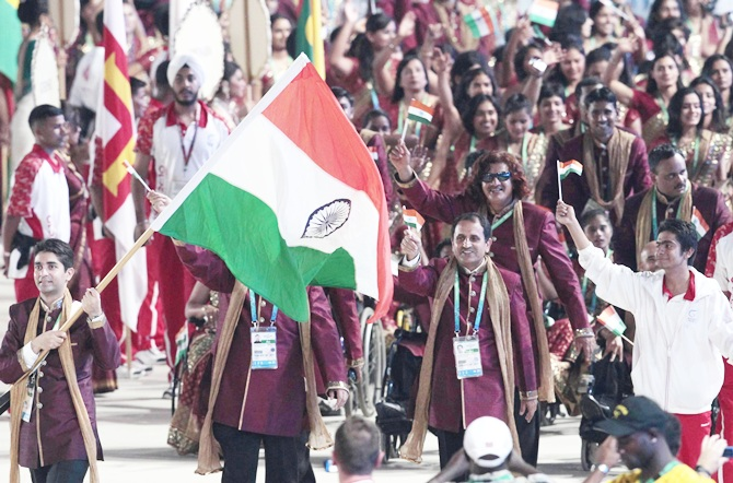 Flag bearer Abhinav Bindra of India leads his team into the Jawaharlal Nehru Stadium during the opening ceremony for the Commonwealth Games in New Delhi 2010