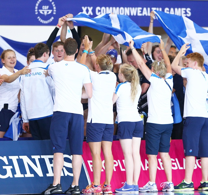 Gold medallist Ross Murdoch of Scotland walks through a guard of honour