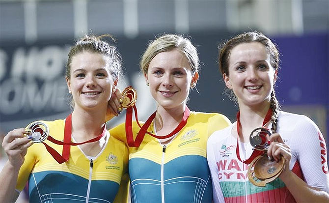 Australia's Annette Edmondson (centre) holds her gold medal with compatriot and silver medal winner Amy Cure (left) and bronze medal winner Elinor Barker of Wales after the women's 10km scratch cycling race at the 2014 Commonwealth Games in Glasgow, Scotland on Saturday
