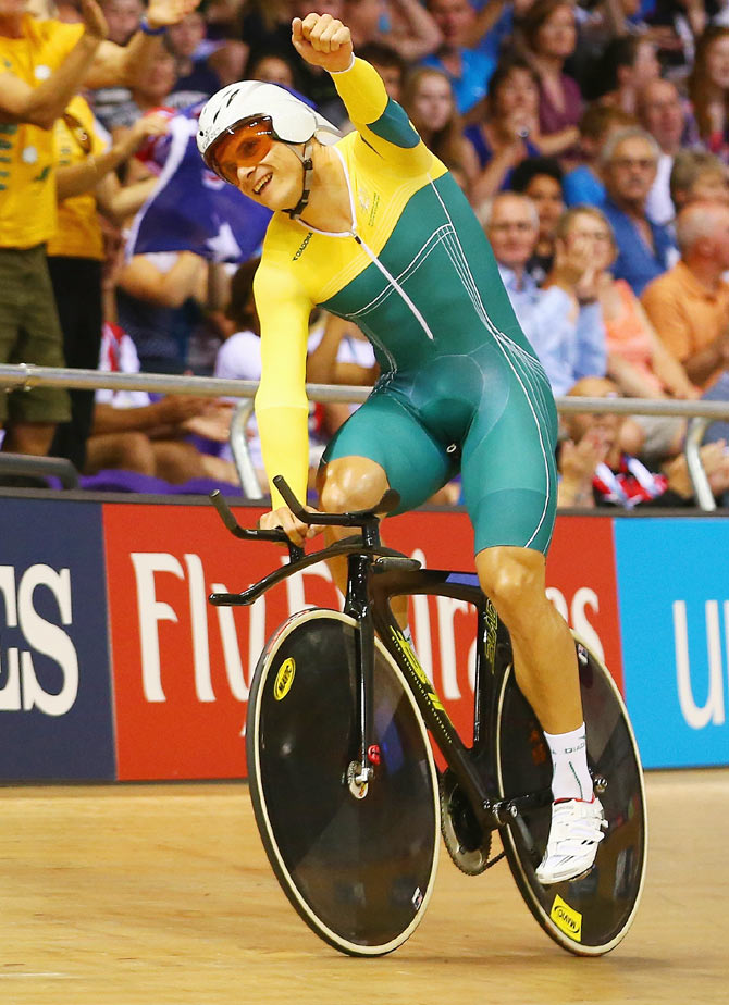 Scott Sunderland of Australia celebrates winning gold after the Men's 1000 metres Time Trial at Sir Chris Hoy Velodrome on Saturday
