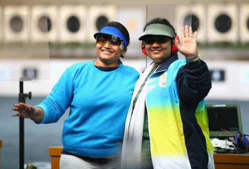 Gold Medalist Rahi Sarnobat of India (L) and Silver Medalist Anisa Sayyed of India (R) celebrate together at the end of the Women's 25m Pistol Shooting on Saturday