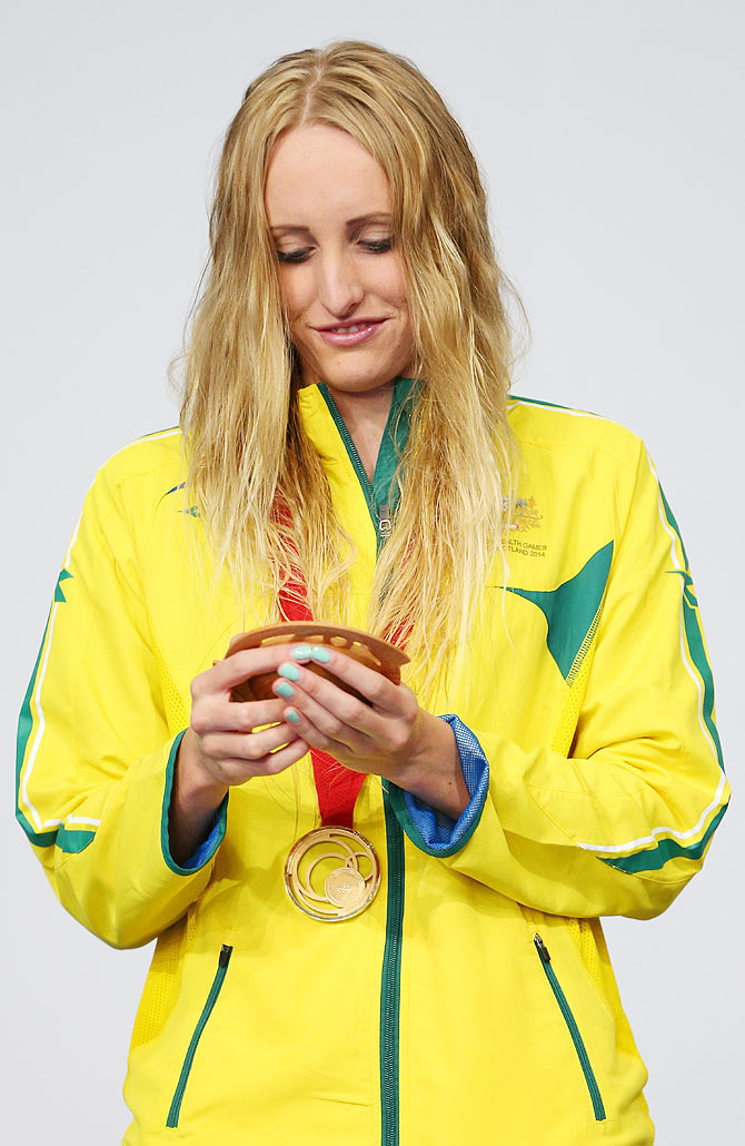 Gold medallist Taylor McKeown of Australia looks at her medal during the medal ceremony for the Women's 200m Breaststroke Final at Tollcross International Swimming Centre on Day 3 of the Glasgow 2014 Commonwealth Games on Saturday