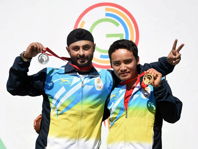Jitu Rai (right) and Gurpal Singh of India celebrate after winning the gold and silver medal at Commonwealth Games in Glasgow