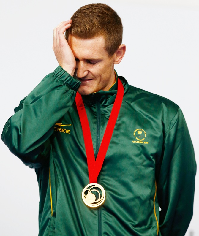 Gold medallist Cameron van der Burgh of South Africa gets emotional during the medal   ceremony for the Men's 50m Breaststroke Final at Tollcross International Swimming Centre during day five of the Glasgow 2014 Commonwealth Games