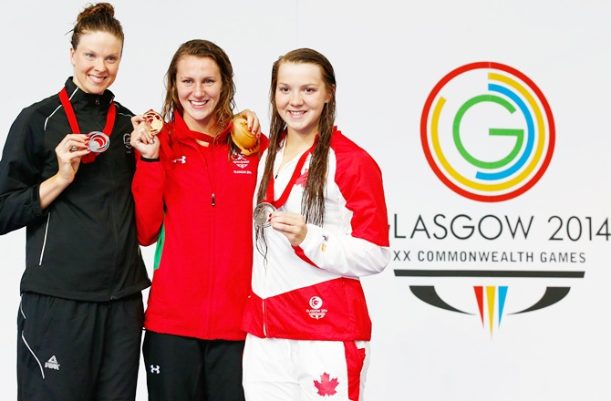 Gold medallist Jazz Carlin of Wales poses with silver medallist Lauren Boyle of New Zealand and bronze medallist Brittany Maclean of Canada during the medal ceremony for the Women's 800m Freestyle Final