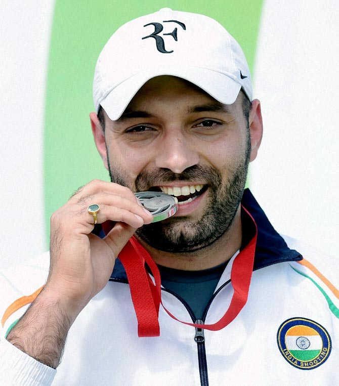 India's Harpreet Singh celebrates after winning the silver medal