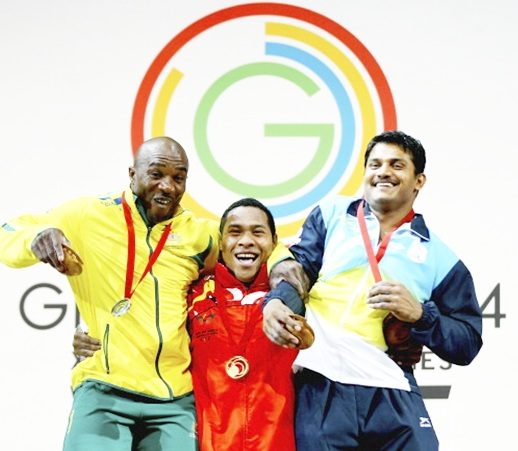 From left, Silver Medalist Simplice Ribouem of Australia, Gold Medalist Steven Kukuna Kari of Papua New Guinea and Bronze Medalist Chandrakant Dadu Mali of India celebrates on the podium