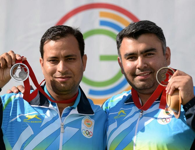 India's silver medal winner Sanjeev Rajput (left) and bronze medallist Gagan Narang