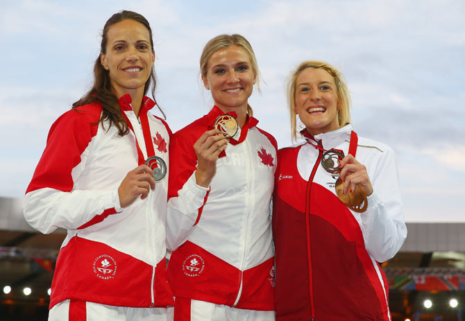 Silver medallist Jessica Zelinka of Canada, gold medallist Brianne Theisen-Eaton of Canada and bronze medallist Jessica Taylor of England pose on the podium during the medal ceremony for the Women's Heptathlon at Hampden Park on day seven of the Glasgow 2014 Commonwealth Games on Wednesday