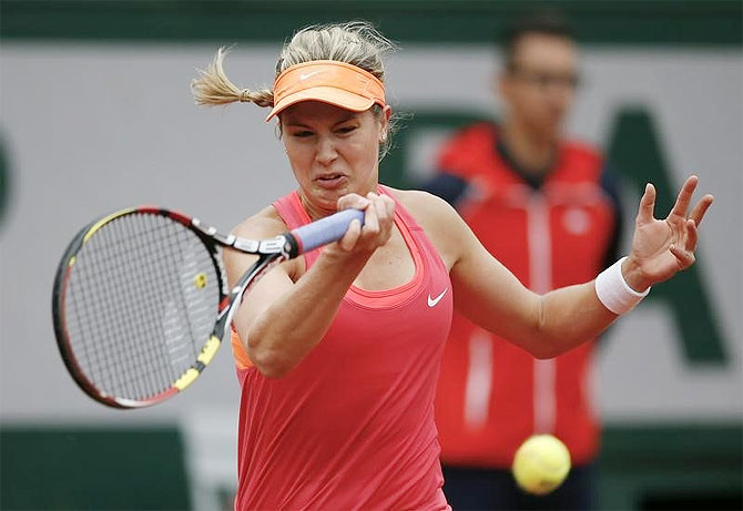 Eugenie Bouchard of Canada returns a forehand to Angelique Kerber of Germany during their women's singles match at the French Open tennis tournament at the Roland Garros stadium in Paris on Sunday