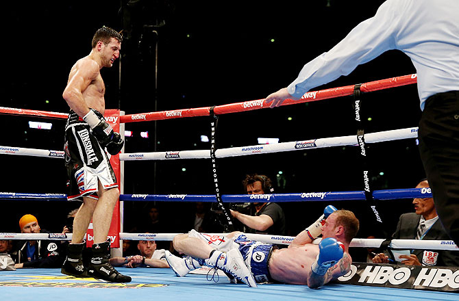 George Groves is kncoked down by Carl Froch in their IBF and WBA World Super Middleweight bout at Wembley Stadium in London on Saturday
