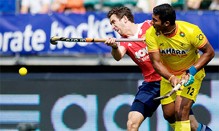 Action from the Hockey World Cup match played between India and England on Monday