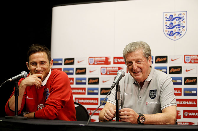 Frank Lampard (left) and manager Roy Hodgson talk to the media during an England press conference at The Sunlife Stadium in Miami, Florida on Tuesday