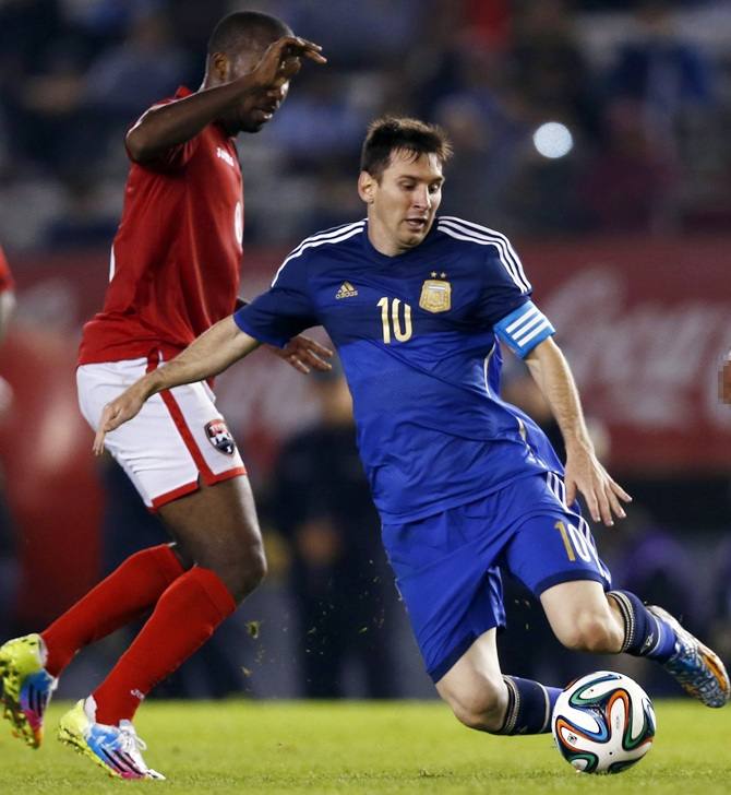 Argentina's Lionel Messi (right) is challenged by Trinidad and Tobago's Khaleem Hyland.