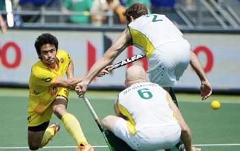 India's Kothajit Khadangbam is thwarted by Australia's Robert Hammond (No 6) and Liam de Young.