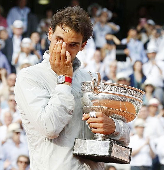 Rafael Nadal of Spain cries as he attends the trophy ceremony after defeating Novak Djokovic of Serbia on Sunday