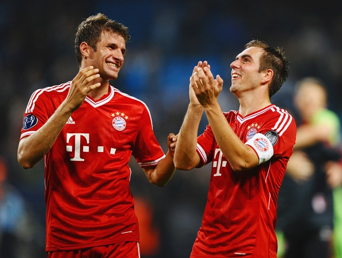 Thomas Muller and Philipp Lahm of FC Bayern Muenchen celebrate