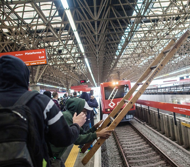 Public transportation users invade subway tracks in the Corinthians   Itaquera station, near Arena Corinthians stadium where the opening of the FIFA Soccer World Cup will take place