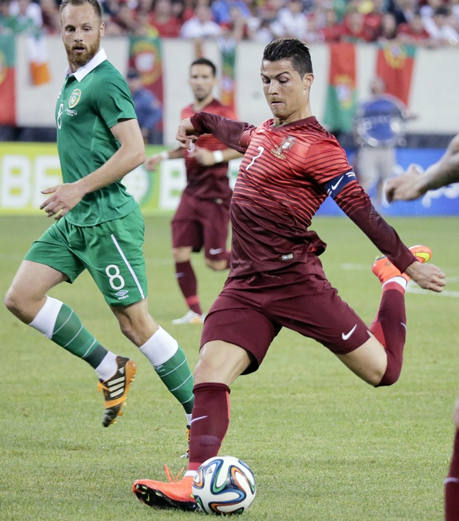 Portugal's Cristiano Ronaldo tries a shot past Ireland's David Meyler