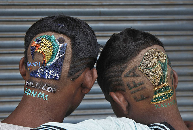 Indian soccer fans pose after getting fancy hairdos