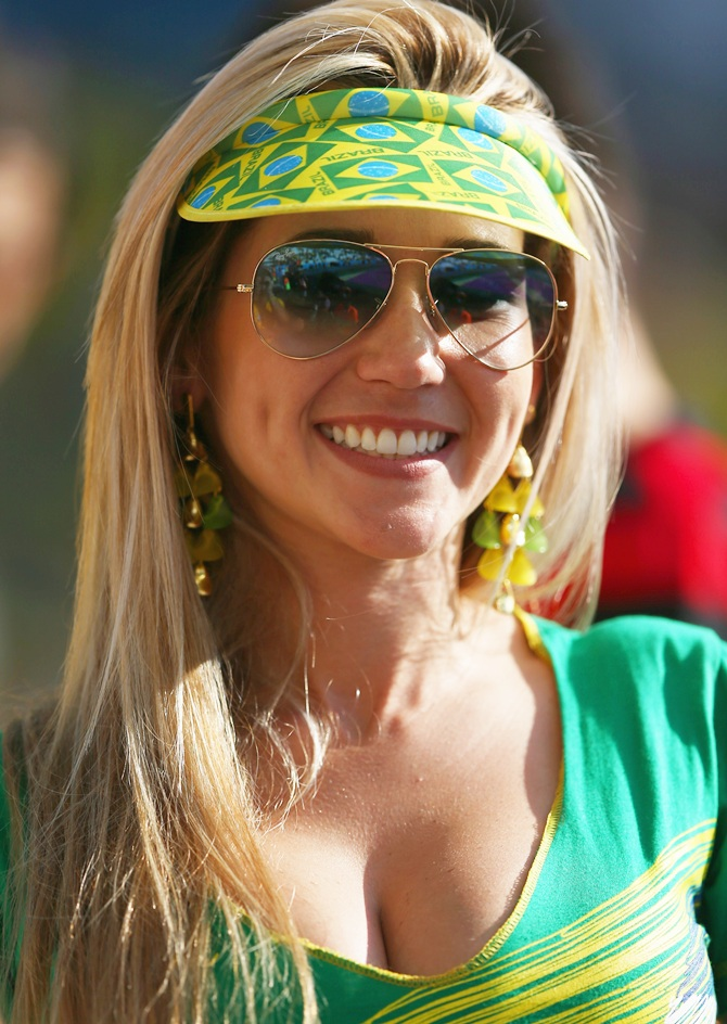 A Brazil fan poses before the Opening Ceremony