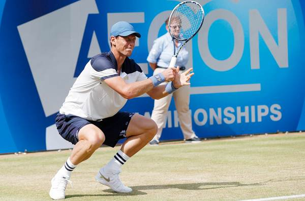 Czech Republic's Tomas Berdych reacts during his men's singles tennis match against Spain's Feliciano Lopez at the Queen's Club Championships