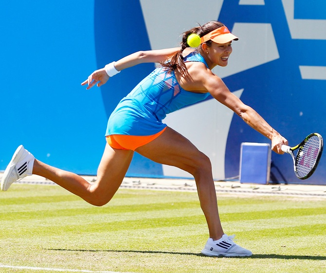 Ana Ivanovic of Serbia hits a return