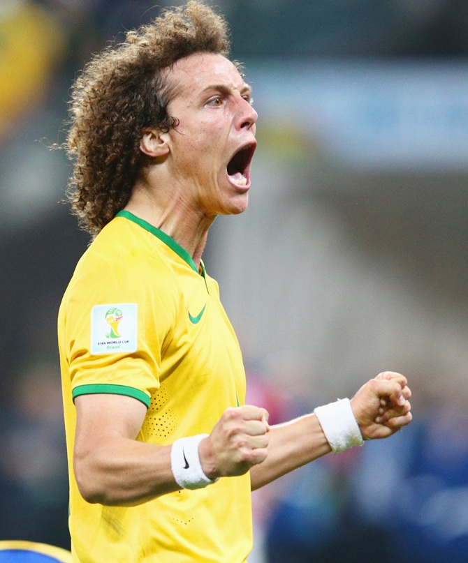 David Luiz of Brazil reacts