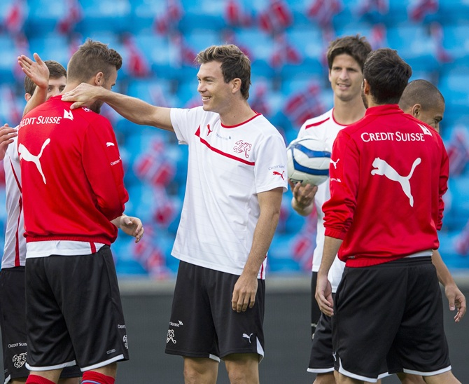 Swiss national soccer team player Stephan Lichtsteiner, centre, attends a training session