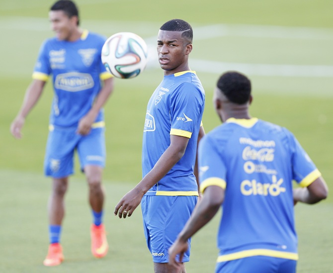 Ecuador's national soccer team player Erazo, centre, controls the ball during a training session in Brasilia