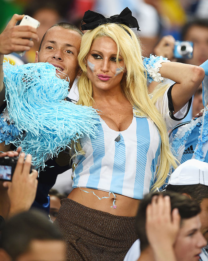 An Argentina fans take a selfie in the crowd prior to the 2014 FIFA World Cup Brazil Group F match between Argentina and Bosnia-Herzegovina at Maracana in Rio de Janeiro on Sunday