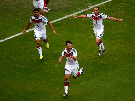 Mats Hummels of Germany (No 5) celebrates with teammates Sami Khedira (left) and Benedikt Hoewedes (right) after scoring his team's second goal