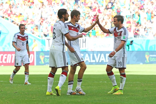 Thomas Mueller of Germany (second right) celebrates with teammates Sami Khedira (second left) and Mario Goetze (right) after scoring his team's third goal