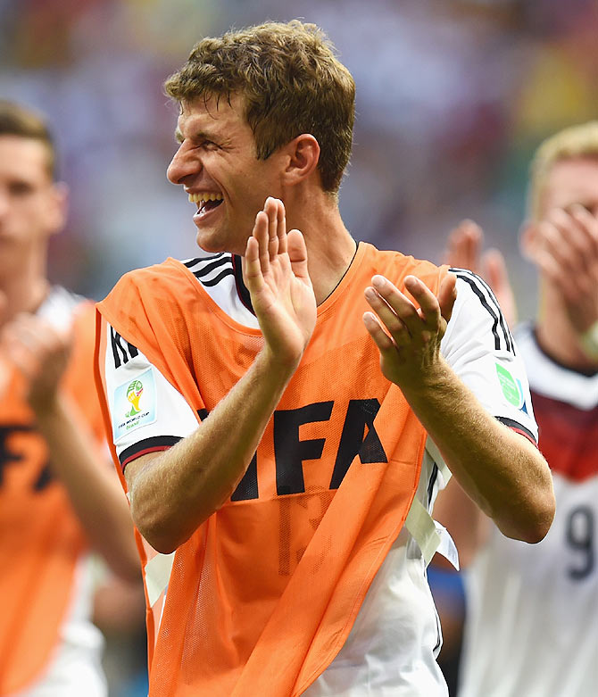 Thomas Mueller of Germany acknowledges the fans after scoring a hat-trick against Portugal