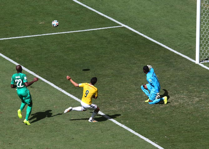 Teofilo Gutierrez of Colombia (centre) misses a chance to score in the first half.