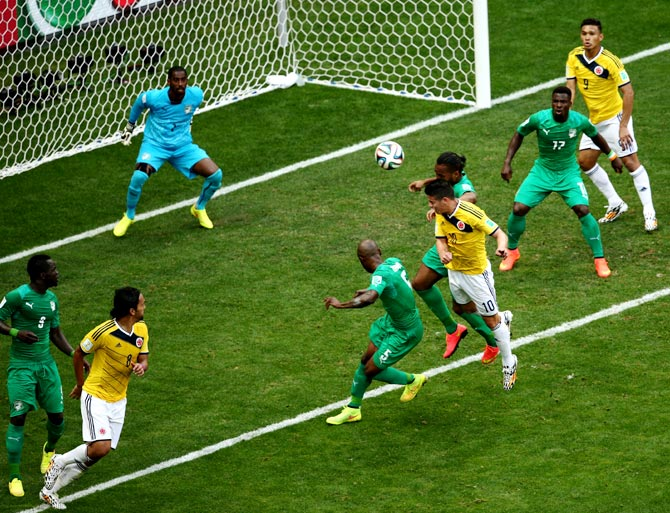 James Rodriguez of Colombia (centre) scores his team's first goal