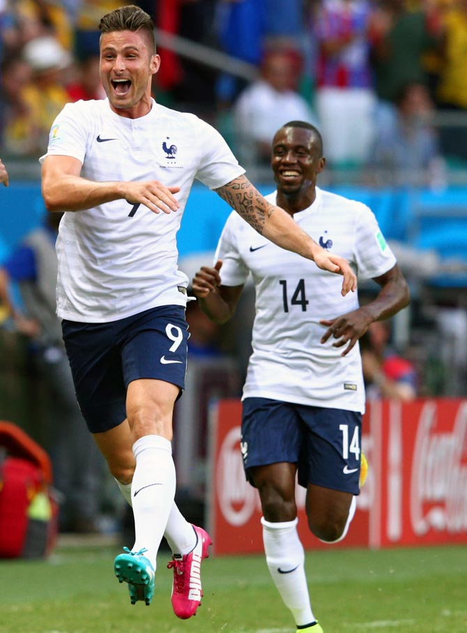Olivier Giroud of France (left) celebrates scoring his team's first goal