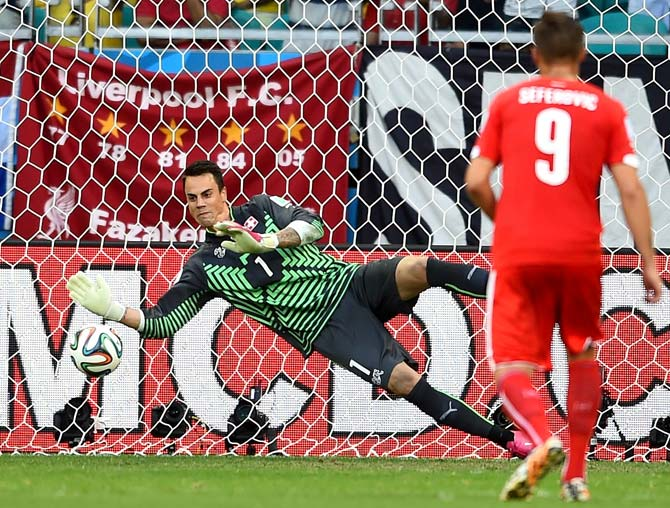 Switzerland goalkeeper Diego Benaglio saves the penalty from Karim Benzema