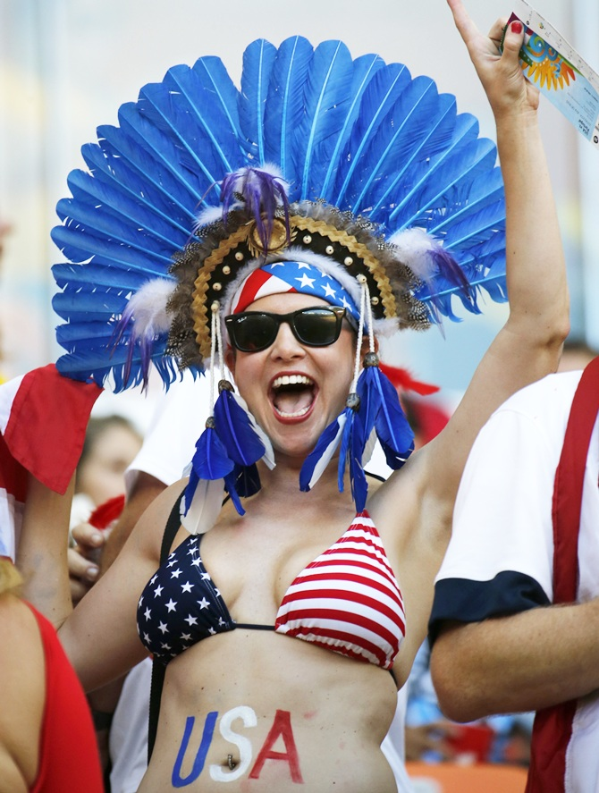 A US fan cheers during the 2014 World Cup G match between Portugal and the US at the Amazonia arena in Manaus