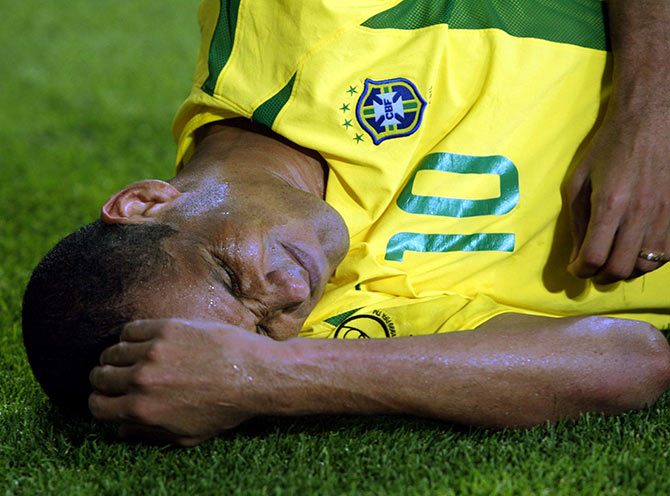 Brazilian midfielder Rivaldo lies near the corner flag
