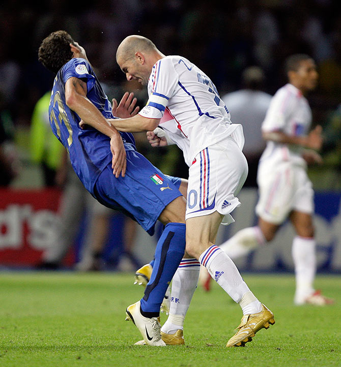 Italy's Marco Materazzi (left) falls on the pitch after being head-butted by France's Zinedine Zidane