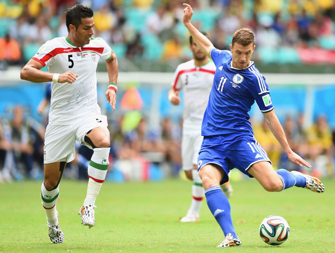 Edin Dzeko of Bosnia and Herzegovina shoots and scores his team's first goal