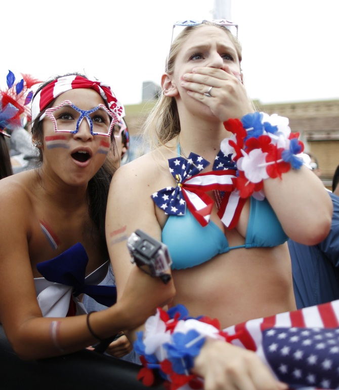 US fans react during the 2014 World Cup Group G match between Germany and the US at a viewing party in Hermosa Beach, California