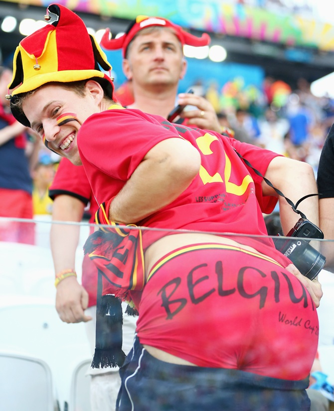 A Belgium fan poses during the 2014 FIFA World Cup Brazil Group H match between South Korea and Belgium at Arena de Sao Paulo