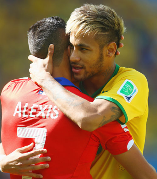 Neymar of Brazil hugs Alexis Sanchez of Chile